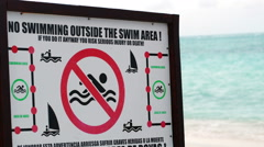 Warning board with restrictions on the beach Stock Footage