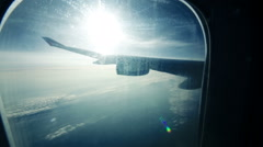 Scenic view of clouds and plane wing from illuminator Stock Footage