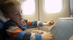Little boy in the plane with wooden box Stock Footage