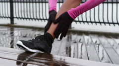 Close up of a woman stretching in preparation for a run Stock Footage