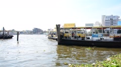 People use Ferryboat for crossing Chao Phraya River at Bangkok Thailand. Stock Footage