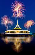 Beautiful building with reflex on the lagoon againt blue sky and fireworks ba Stock Photos
