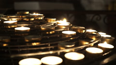 Small tea light candles in a church Stock Footage