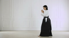 beautiful woman wearing a hakama engaged in Jiu Jitsu 2 - stock footage