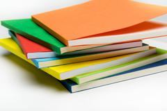 Pile of colorful notebooks Stock Photos