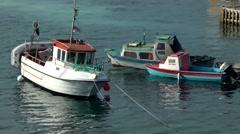 Greenland small town Qaqortoq 009 small Scandinavian fishing boats at anchor - stock footage