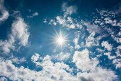 Stock Photo of Summer Sky With Sun And Clouds