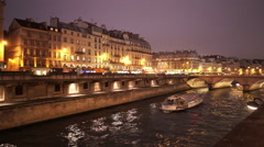 The banks of River Seine in Paris by night Stock Footage