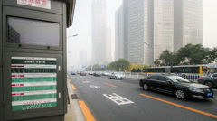 In the bad weather,the Bus stop and the traffic at Chang'an Avenue - stock footage
