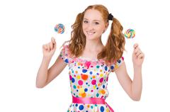 Redhead young girl with lolipops isolated on white - stock photo