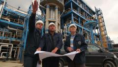 engineers with blueprints at the factory - stock footage
