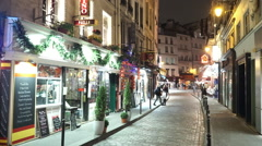 Narrow lanes in Paris Latin quarter by night Stock Footage
