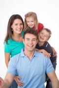amused family on white background - stock photo