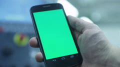 Worker is Using Smartphone With Green Screen in Portrait Mode in Factory Stock Footage