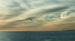 Helicopter Flying Water Colorful Beautiful Sunset Sky over Sea Blue Ocean Stock Footage