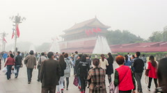 People are happy to visit the Tian'anmen Square and take photos in bad weather - stock footage