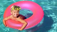 young kid having fun in swimming pool - stock footage