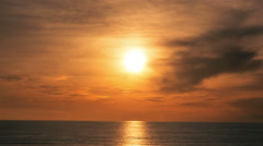 Blazing Orange Sunset Beach Ocean Clouds Evening Colorful Beautiful Water - stock footage