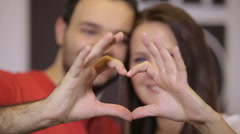 Happy couple making heart shape Stock Footage