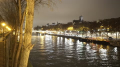 City lights of Paris mirroring in River Seine - stock footage