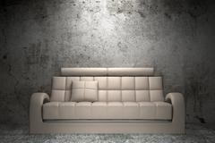 Stock Illustration of beige leather sofa in front of grunge concrete wall