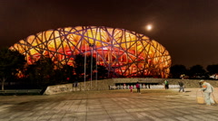 Walking outside of the National stadium Park in Beijing, China Stock Footage