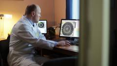 Doctor looking at a snapshot of the eye Stock Footage