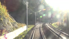 ULTRA HD 4K POV Point of view train pass railway mountain forest sun light day Stock Footage