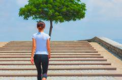 Runner girl - athlete running the stairs, woman fitness Stock Photos