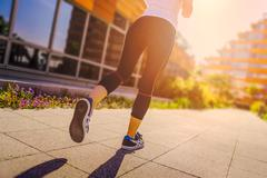 Runner girl - athlete running in the city, woman fitness Stock Photos