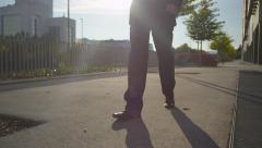 CLOSE UP: Man wearing a suit walking on the sidewalk - stock footage