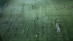 Stock Video Footage of Soccer evening training, teenagers playing game on the green field, winter