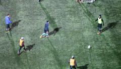 Stock Video Footage of Action camera tracking soccer players and ball when playing game on green