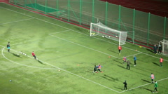 Stock Video Footage of Football training at green field. Teenage soccer section