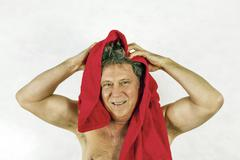man toweling hair after shower - stock photo