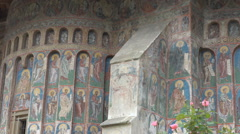 Beautiful orthodox church painted wall blue color ancient medieval building day Stock Footage