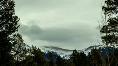 Timelapse clip of cold mountain scape in the clouds Stock Footage