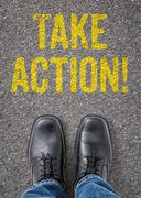 Text on the floor - take action Stock Photos