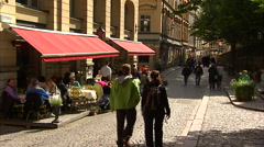 Cobblestone street and cafes, Stockholm Stock Footage