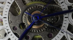 Time lapse macro clip of watch gears and hands moving - stock footage