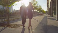 SLOW MOTION: Businessman and businesswoman going to work in a morning Stock Footage