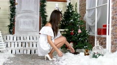 Pretty woman playing with snow in studio Stock Footage