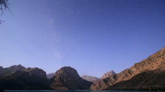 Moon over mountain lake. Zoom. Tajikistan, Iskander-Kul. Time Lapse. 1280x720 Stock Footage