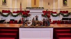Nativity scene figures staged inside of church Stock Footage