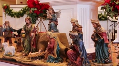 Stock Video Footage of small nativity scene on communion table in church sanctuary