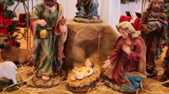 Nativity scene with focus on baby jesus in manger Stock Footage