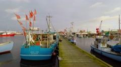 Walking between the fishing vessels Stock Footage