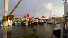 Fishing vessels side by side in the marina Stock Footage