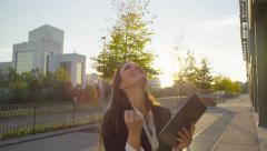 Smiling young businesswoman gets great news on digital tablet Stock Footage
