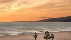 Sunset Sandy Beach Pacific Ocean West Coast Santa Monica California Vacation - stock photo